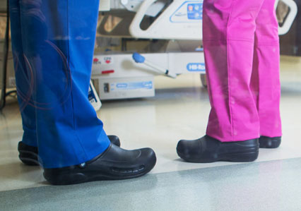 Two people wearing Crocs