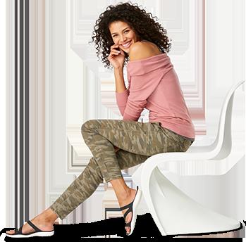 Woman posing in modern chair wearing Women's Swiftwater™ Sandal